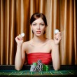 Woman with chips at the playing table — Stock Photo