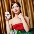 Female gambler keeps chips in hand — Stock Photo