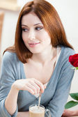 Woman with red rose at the cafe — Stock Photo