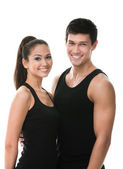 Two sportive in black sportswear embrace — Stock Photo