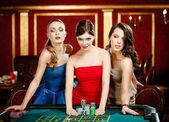 Three ladies place a bet playing roulette — Stock Photo