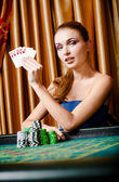 Female gambler at the poker table with cards and chips — Stock Photo