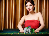 Woman bets pile of chips playing roulette — Stock Photo