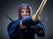 Close up of kendoka training with shinai — Stock Photo