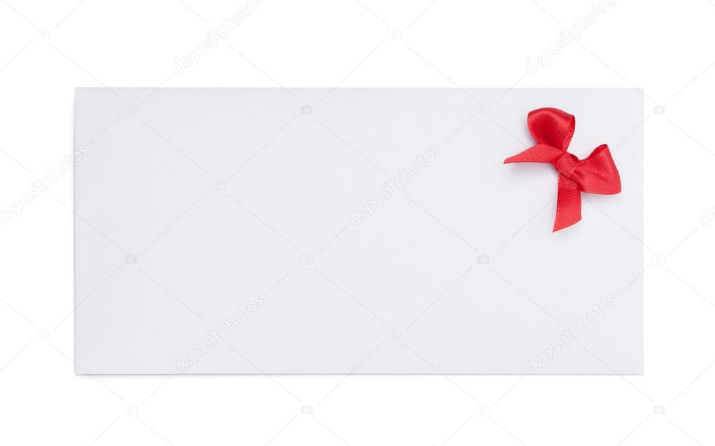 Envelope with red ribbon bow, isolated on white. Symbol of party and happy holiday — Stock Photo #19385493