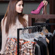 Choosing fascinating shoes — Stock Photo