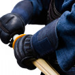 Close up of hands in kote with shinai - Stock Photo