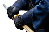 Close up of hands in kote with shinai — Stock Photo