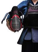 Close up of kendo helmet in hands of kendo fighter — Stock Photo