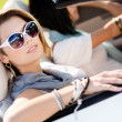 Close up of girls in sunglasses in the automobile - Stock Photo