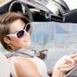 Girls with the highway map in the car — Stock Photo #19637895