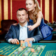 Stock Photo: Womadvises gambler safe bet