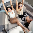 Top view of women in the cabriolet with their hands up — Stock Photo