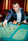 Gambler stakes playing at the casino table — Stock Photo