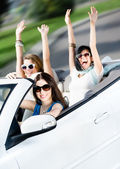 Group of happy teenagers in the white car — Stock Photo