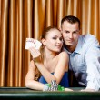 Young couple playing poker — Stock Photo #19640379