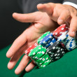 "Poker player stakes ""all in"" pushing his chips forward — Stockfoto"