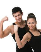 Zwei sportliche zeigen ihre bizeps — Stockfoto