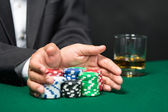 "Male player going ""all in"" pushing his chips forward — Stock Photo"