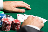 Poker player opens his poker cards — Stock Photo