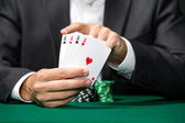 Poker player shows poker cards 4 aces — Stock Photo