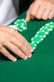 Gambler puts the poker chips on the table — Stock Photo