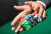 "Poker player stakes ""all in"" pushing his chips forward — Stock Photo"