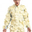 Young male with a sticky note on his face, covered with yellow sticky notes — Stock Photo #19992623