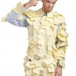 The young man covered with yellow sticky notes — Stock Photo #19992665