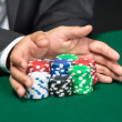 "Gambler going ""all in"" pushing his poker chips forward — Stock Photo"