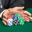 "Stock Photo: Gambler going ""all in"" pushing his poker chips forward"