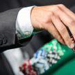 Gambler stakes the pile of chips — Stock Photo