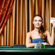 Female gambler at the poker table — Stock Photo