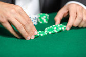 Gambler puts the chips on the table — Stock Photo