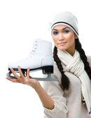 Pretty female figure skater shows one skate — 图库照片