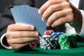Gambler playing poker cards with chips on the poker table — Stock Photo