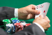 Gambler with full house on hands — Stock Photo