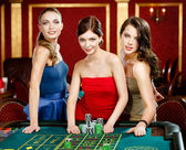Three women stake playing roulette — Stock Photo