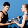 Trainer shows woman the correct exercise performing — Stock Photo