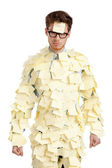 Young man with a sticky note on his face, covered with yellow stickers — Stock Photo