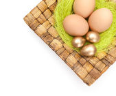 Easter eggs are on braided plate — Stock Photo