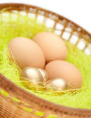 Easter eggs are in wattled basket, close up — Stock Photo