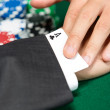 Poker player cheats with card from the sleeve — Stock Photo