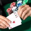 Gambler shows poker cards 4 aces — Stock Photo #20303949