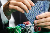 Gambler playing poker cards with poker chips on the poker table — Stock Photo