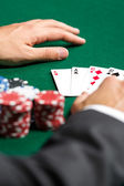 Poker player opens his cards — Stock Photo