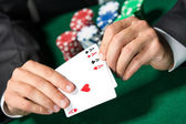 Gambler shows poker cards 4 aces — Stock Photo