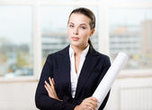 Female engineer with sketch — Stock Photo