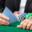Stock Photo: Gambler playing cards with poker chips on the table