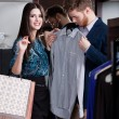 Woman recommends the shirt to her boyfriend — Stock Photo #21255173